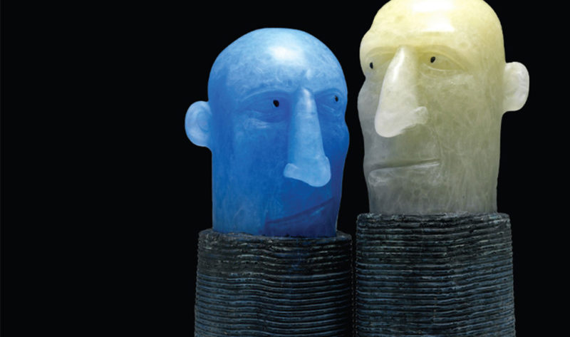Two ceramic heads looking at each other